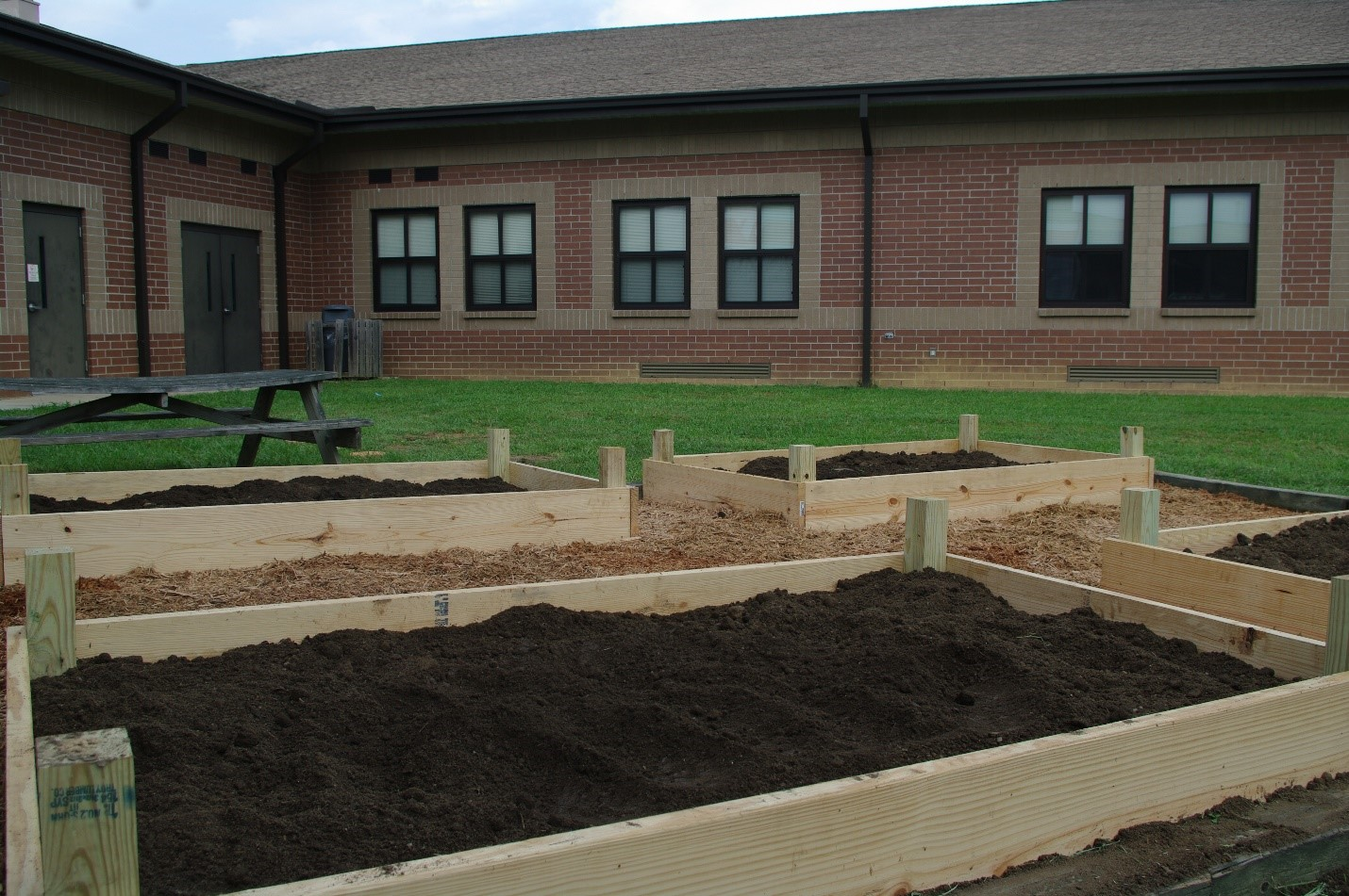 Cane Creek Middle School Landscaping done by Asheville Mulch Yard
